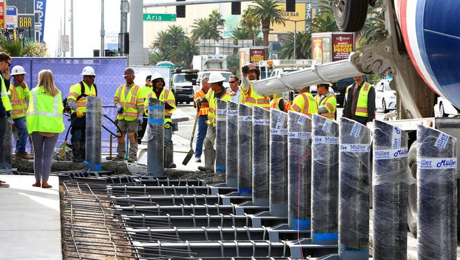 Steel posts are installed on the Strip near Aria hotel-casino on Nov. 13, 2017. The cost of steel has seen a significant increase as talk about tariffs started heating up.