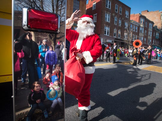 The annual tradition of Lebanon's Holiday Parade continued Saturday morning, Nov. 25, after being rescheduled due to inclement weather. Hundreds lined the edge of Cumberland to watch a kick off of the holiday season. After finishing his parade duties Santa climbed to the top of the Lebanon Farmer's Market and waved to the crowd.