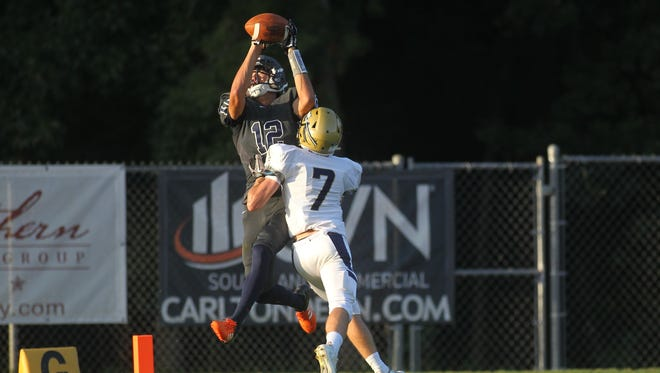 Maclay's Matt Boynton high points a ball for a 35-yard touchdown from Brecht Heuchan.