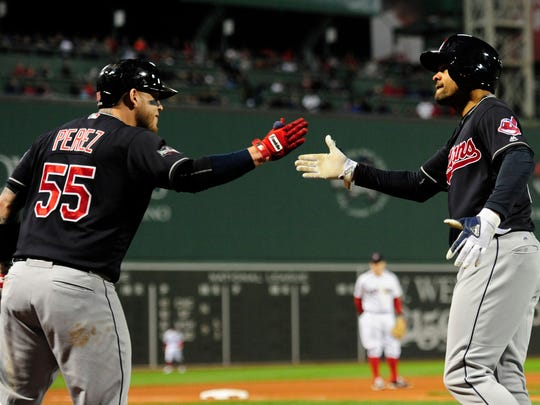 Cleveland Indians left fielder Coco Crisp (4) celebrates with catcher Roberto Perez (55) after hitting a two-run home run in the sixth inning against the Boston Red Sox during game three of the 2016 ALDS playoff baseball series at Fenway Park.