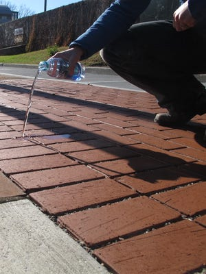 Spare the storm-drain: Water sinks between pervious pavers on South Winooski Avenue at Main Street in mid-November, 2015.