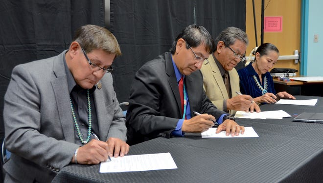 Speaker LoRenzo Bates, left, Vice President Jonathan Nez, President Russell Begaye and Chief Justice JoAnn B. Jayne sign a proclamation recognizing the sesquicentennial anniversary of the treaty between the tribe and the U.S. government on Friday at the Navajo Nation Museum in Window Rock, Ariz.