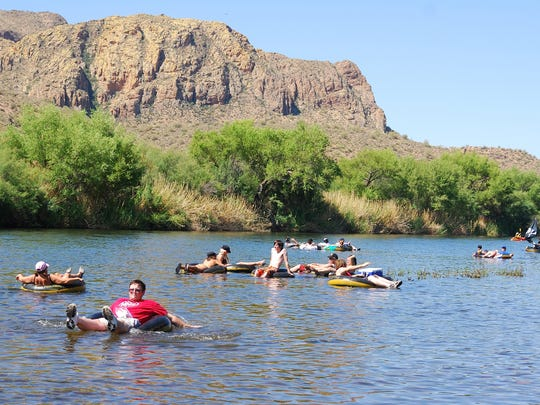 Swimmers float down the Salt River.