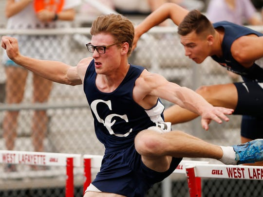 Cooper Boehm of Central Catholic runs to a second place finish in the 110 meter hurdles during the boys track and field sectional Thursday, May 18, 2017, in West Lafayette. The meet was called about half way through due to thunderstorms in the area. It will resume on Friday.