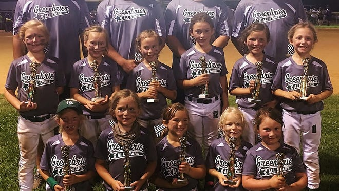 The Greenbrier Lady Cats 6u softball team are all smiles after winning the district tournament.