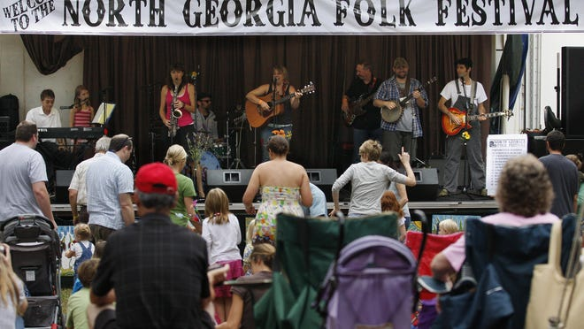 In this undated file photo, folk music fans dance to the sounds of Pam Blanchard and the Sunny Side Up Band on Saturday at Sandy Creek Park during the North Georgia Folk Festival.