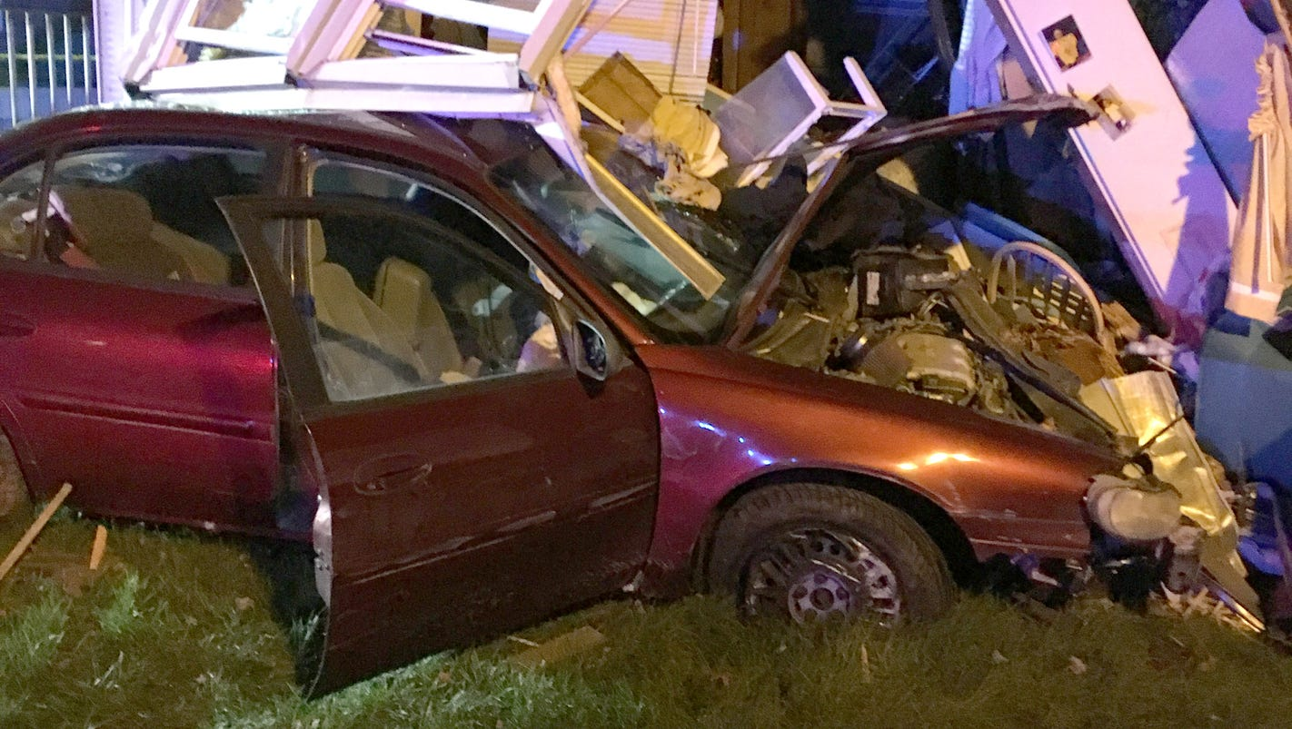 Cops: Man hits police car, flees, crashes into mobile home