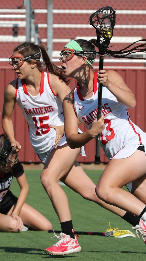 North Rockland's Aleya Corretjer (15) and Kerri Gutenberger (13) during the Section 1 Class A girls lacrosse championship at the Torne Valley Athletic Center May 23, 2018.