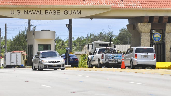 In this file photo, traffic passes through the gates of Naval Base Guam.