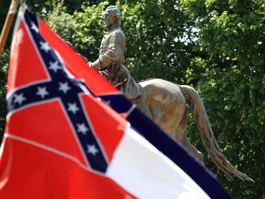 A Mississippi state flag waves in front of the statue and grave of Civil War general Nathan Bedford Forrest at Health Sciences Park on July 12, 2015.