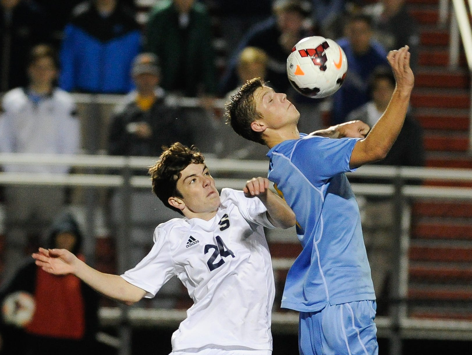 Cape Henlopen's #2 Jack Ashby gains control of the ball over Salesianum's #24 John Leonard in the second half of the DIAA Division I soccer semifinal game at Smyrna High School.