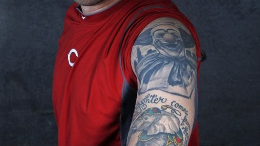 Cincinnati Reds pitcher Trevor Bell shows his tattoos, in honor of his grandfather, Bob Bell, who was famous for his alter-ego, Bozo the Clown. He was the original portrayer of the character for Chicago superstation WGN-TV.