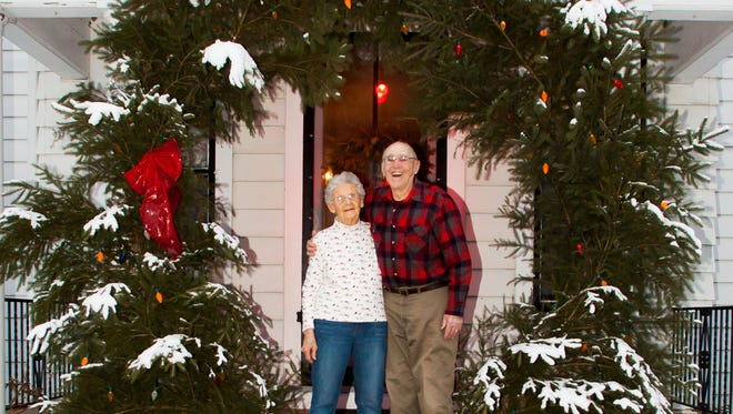 Barbara and Jim Connell of Pewaukee welcome visitors to their home with a giant wreath on Wednesday, Dec. 19, 2012. Jim was well known for creating the unique 8x8-foot wreath by hand each year.