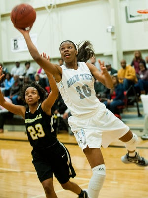 Brewbaker Tech's Bianca Jackson shoots against Greenville's Adrienna Taylor in area tournament action on Saturday.