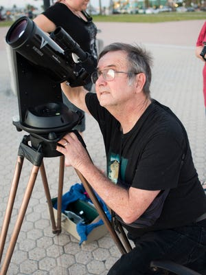 Pensacola State College astronomy professor Wayne Wooten prepares on March 31, 2017,  for a night of stargazing at Casino Beach in Pensacola.