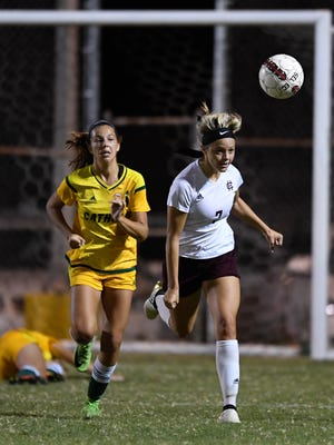 Henderson's Carlee Crafton (7) tries to head the ball the ball out of Colonel territory as the Lady Colonels play Owensboro Catholic in the last game of the regular season at Colonel field Thursday, October 5, 2017.