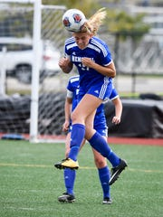 Memorial's Grace Lensing heads a ball away during the Tigers' semistate victory over Bishop Chatard at North's Bundrant Stadium on Saturday, October 21, 2017.