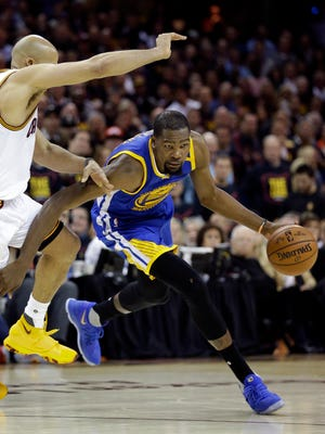 Golden State Warriors forward Kevin Durant (35) drives on Cleveland Cavaliers forward Richard Jefferson (24) during the first half of Game 3 of basketball's NBA Finals in Cleveland, Wednesday, June 7, 2017. (AP Photo/Tony Dejak)