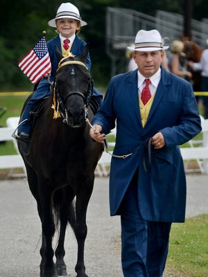 Ronnie Stanfill leads his grandson Cason Cagle on their horse Playboy's Gold Digger at the Mid-South Horse Show Association's 29th Annual Charity Horse Show benefiting YouthTown, Saturday.