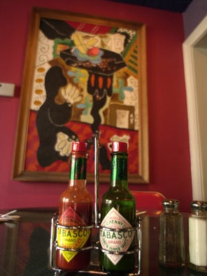 Festive artwork graces the walls in the dining area of Mex.