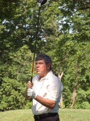 Frank Thacker watches his tee shot on the 15th hole