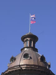 Flags flying on the SC Statehouse dome February 1, 2000.