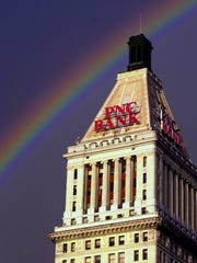 A rainbow appears over the PNC Tower, whose distinctive