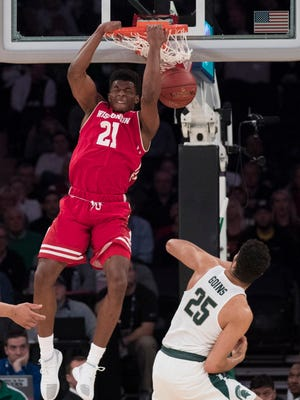 Wisconsin guard Khalil Iverson soars over Michigan State's Kenny Goins for an alley-oop dunk during the Big Ten tournament in New York on Friday.