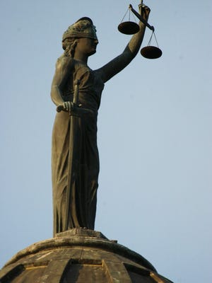 The statue of Justice personified on the Cascade County Courthouse dome.