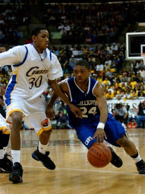 Chillicothe's Anthony Hitchens drives to the hoop against Toledo Libbey's Lance Jones during the 2008 Division II state championship.