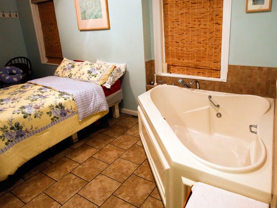 A birthing room at the Birth Center in Wilmington features a tub for water births.