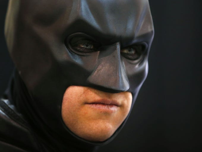 Batman poses at Phoenix Comicon on Saturday, May 27,