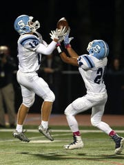 Sparta's Rich McDonald pulls in a interception in front