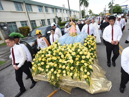 In this file photo, Catholic faithful and others proceed through the streets of Hagåtña during the annual celebration of the Immaculate Conception of the Blessed Virgin Mary.