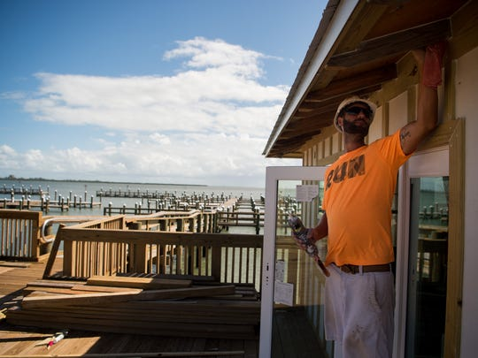 Carpenter James Mascolino, of Vero Beach, works on the dockmaster's quarters, one of two buildings being constructed on the Indian River Lagoon waterfront, at the new Causeway Cove Marina on Thursday, Oct. 19, 2017, in Fort Pierce.