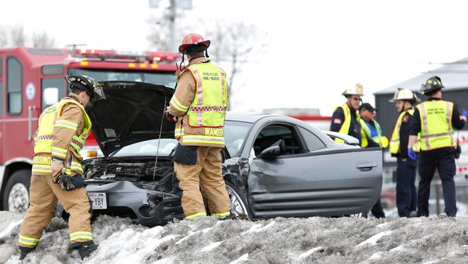 A crew from the Fond du Lac Fire Department  tend to a vehicle that was involved in a two-car crash on West Johnson Street at Rickmeyer Drive on Friday.
