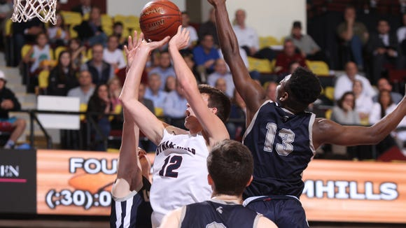 Byram Hills' Ben Leff (12) puts up a shot in the Section 1 Class A boys semifinal basketball game against Our Lady of Lourdes at the Westchester County Center in White Plains on Wednesday, March 1, 2017.