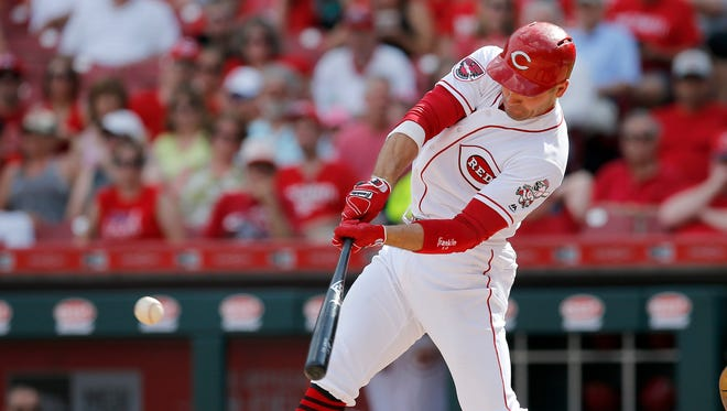 Cincinnati Reds first baseman Joey Votto (19) singles to center field in the bottom of the third inning against the Los Angeles Dodgers at Great American Ball Park on Saturday, June 17, 2017.