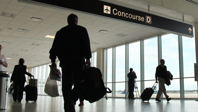 Travelers navigate Southwest Florida International Airport.