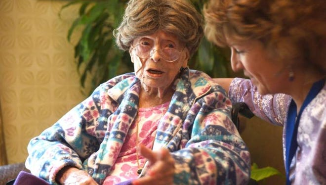 Adele Dunlap, 113, with activities director Susan Dempster at Country Arch Care Center in Pittstown.