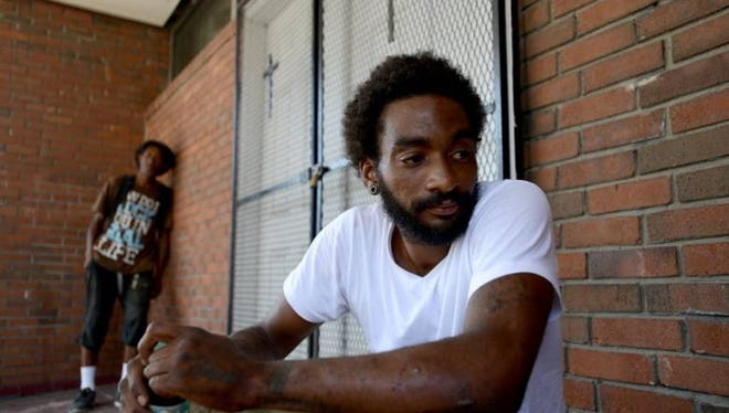 LaVon Russell, who has been homeless in Camden for the last year, sits Monday outside the Camden Miracle Center Church.