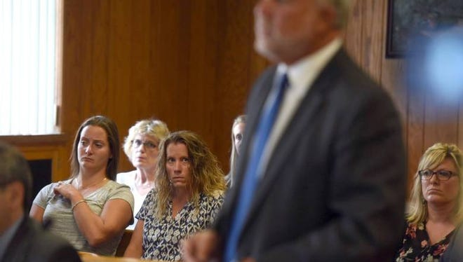 Jaclyn Vanore and Kate Drumgoole listen to their attorney Eric Kleiner in court on Friday.