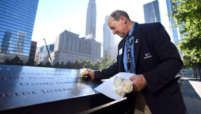 National September 11 Memorial & Museum George Mironis Sr. places a white rose on the first letter of the last name or a middle initial for every victim who would have celebrated a birthday that day.
