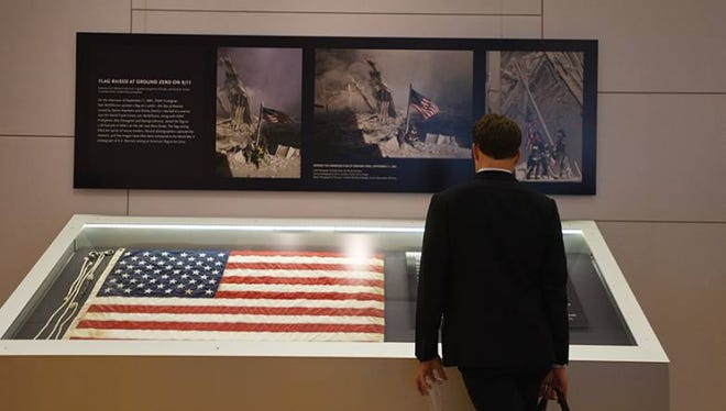 The flag raised by firefighters at Ground Zero on 9/11, captured in an iconic photograph by former Record photographer Thomas E. Franklin, was recovered by the 9/11 Memorial & Museum an unveiled during a ceremony on Thursday morning.