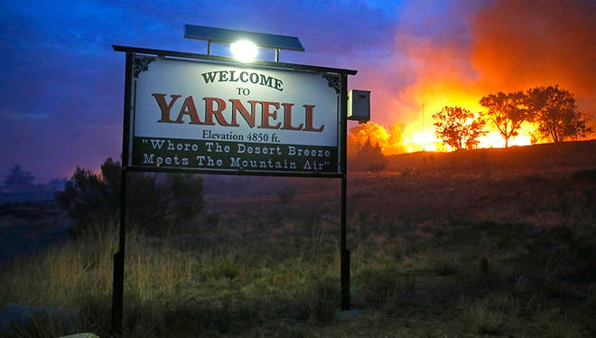 The Yarnell Hill Fire in 2013 killed 19 members of the Granite Mountain Hotshots who were battling the blaze, making it the deadliest wildfire on record in Arizona. Here, homes go up in flames in the area of Glenn Ilah on June 30, 2013, near Yarnell, Ariz.