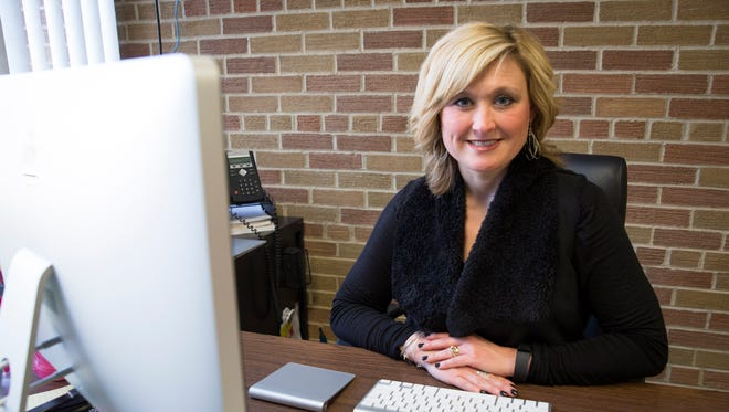 Holly Stachler, the district's technology integration specialist, works at her desk Feb. 6 at Yorktown Middle School. Stachler is a semi-finalist for the The Consortium for School Networking's Next Generation Leaders program.