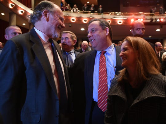Christie, center, and his wife, Mary Pat, with Jon Corzine, the Democrat whom Christie unseated in 2009, at a memorial service for former Gov. Brendan Byrne in Millburn on Monday.