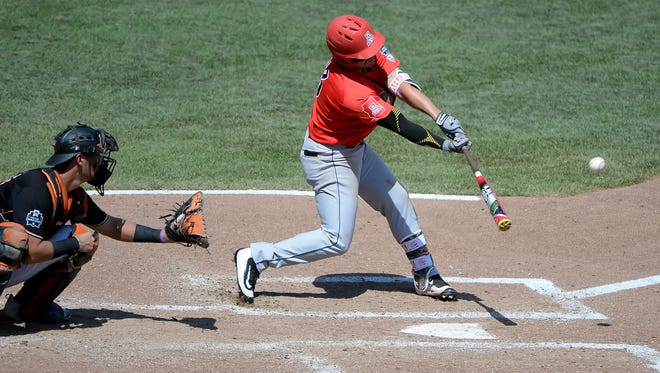 Arizona Wildcats outfielder Zach Gibbons (23) drives in a run with a sacrifice fly in the fourth inning against the Oklahoma State Cowboys in the 2016 College World Series at TD Ameritrade Park.
