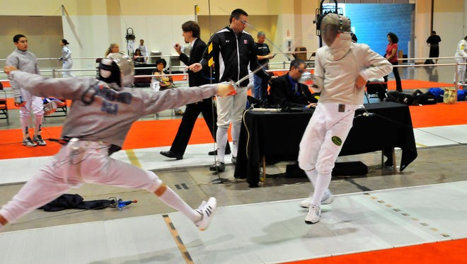 Jacob Behymer-Smith and Soheil Kahavandi practice with the High Desert Fencing Alliance.