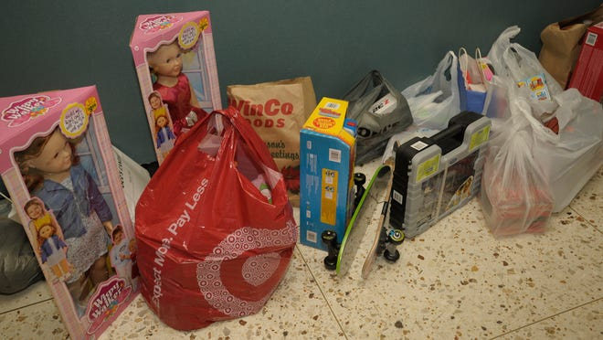 The eighth batch of new and unwrapped toys, and a cash donation from Bunko Forever for the Marine Corps ReserveToys For Tots Thursday at the Visalia Times-Delta.